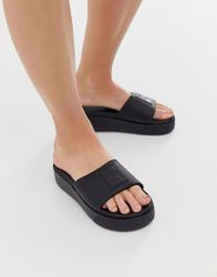 Puma - Slippers met plateauzool in zwart
